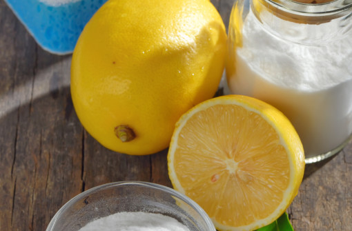 Homemade green cleaning.Lemon and baking soda on old wooden background