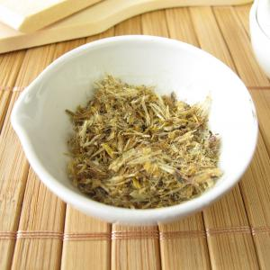 Arnica leaves in white bowl