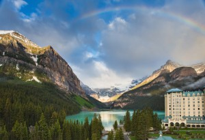 Banff National Park over looking lake. Hotel in corner. Rainbow over top.