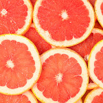 The fresh grapefruit as a background closeup