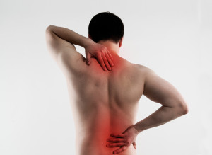 Backache. Young person suffering from lumbar vertebrae disease