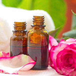 Rose essential aroma oil and fresh flowers